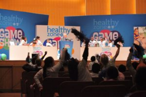 Healthy Zone Game Show JD on stage with audience